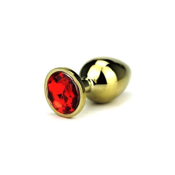 large guld farvet butt plug med rød diamant i bunden