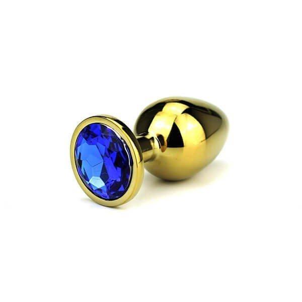Butt plug i guld fra delight med en blå diamant i bunden for dekoration