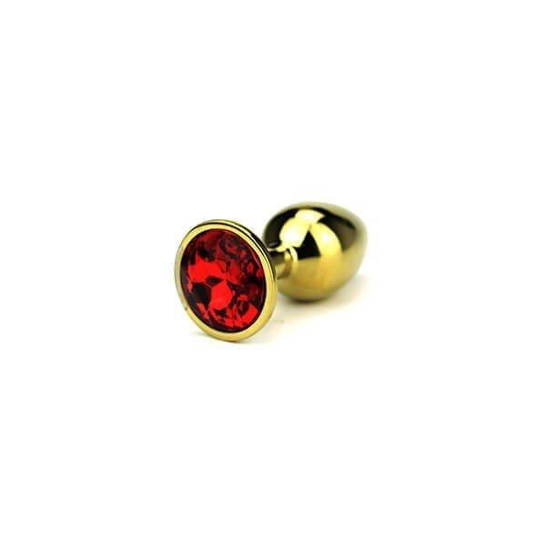 small Delight butt plug i guld farve med rød diamant i foden